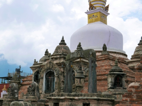 White main dome with Buddha eyes of Chilancho Stupa on top of carved stone and brickwork